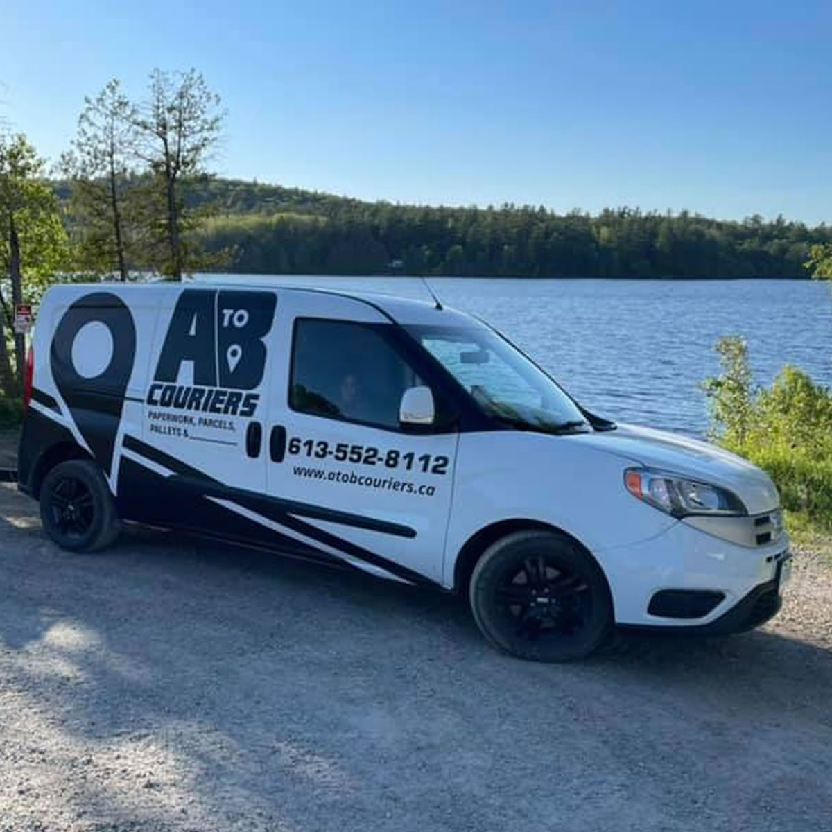 The A to B Couriers delivery van by a lake